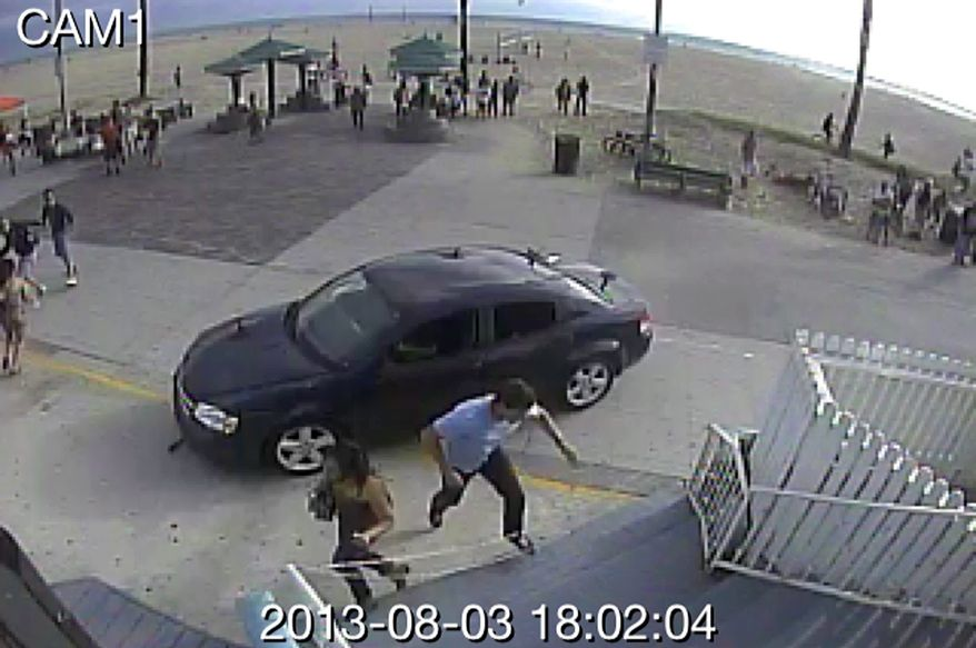In this still frame made from security camera footage from Snapchat Inc. headquarters, pedestrians scatter as a car drives through a packed afternoon crowd along the Venice Beach boardwalk in Los Angeles, Saturday, Aug. 3, 2013. A driver plowed into crowds at the Venice Beach boardwalk in a seemingly intentional hit-and-run that killed a woman and injured 11 others. (AP Photo/Snapchat Inc.)