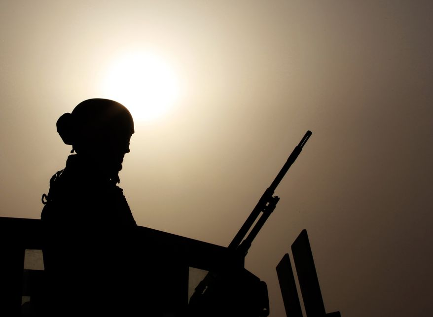 A Bahraini armored personnel vehicle reinforces U.S. Embassy security just outside of a gate to the building in Manama, Bahrain, on Sunday, Aug. 4, 2013. (AP Photo/Hasan Jamali)