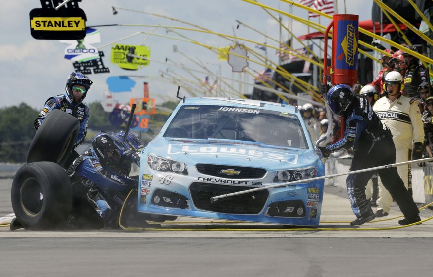 Driver Jimmie Johnson (48) makes a pit stop during a NASCAR Sprint Cup Series auto race, Sunday Aug. 4, 2013, at Pocono Raceway in Long Pond, Pa. (AP Photo/Mel Evans)