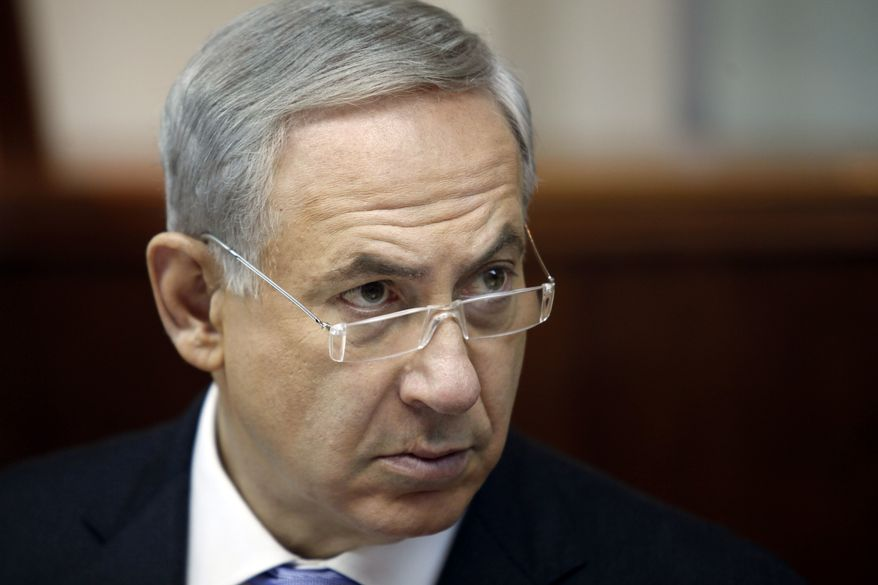 Israeli Prime Minister Benjamin Netanyahu listens during the weekly cabinet meeting in Jerusalem, Sunday, Aug. 4, 2013. (AP Photo/Gali Tibbon, Pool)