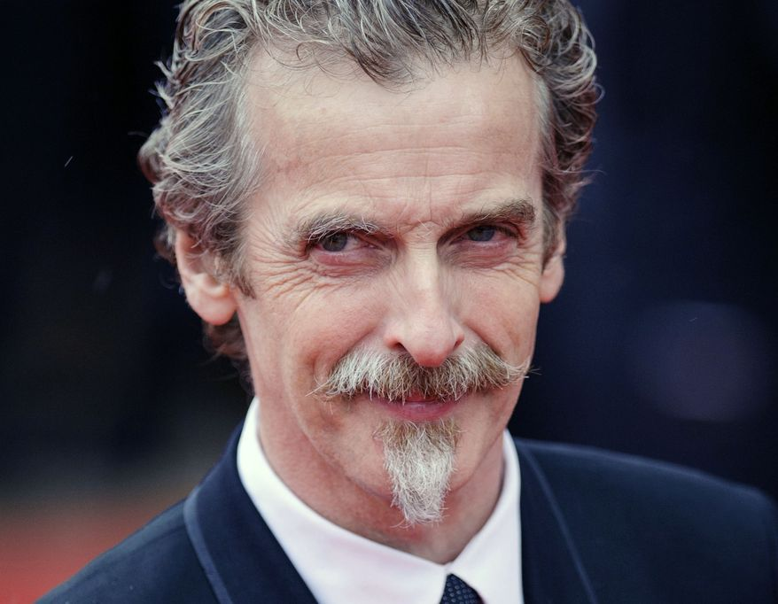 "** FILE ** Glasgow-born actor and Oscar winner Peter Capaldi, as he appeared in London in this file photo dated May 12, 2013. Peter Capaldi was named late Sunday Aug. 4, 2013, as the next lead star for the long-running British science fiction TV series ""Doctor Who."" (AP Photo / Dominic Lipinski, PA, FILE)"