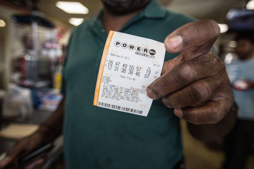 Patrons at a 7-Eleven in Alexandria purchase Powerball lottery tickets in the hope of having the winning number for the jackpot that could pass $400 million by Wednesday night's drawing. Bigger jackpots bring in players who don't play regularly. (Photographs by Andrew S. Geraci/The Washington Times)
