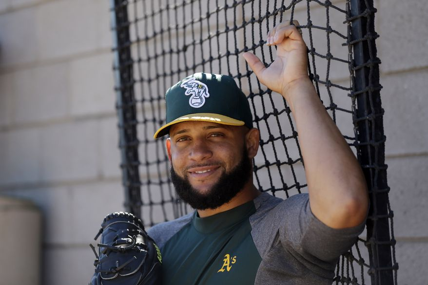 FILE -- Oakland Athletics relief pitcher Jordan Norberto during drills before an exhibition spring training baseball game against the Kansas City Royals on Tuesday, March 12, 2013 in Phoenix. (AP Photo/Marcio Jose Sanchez)