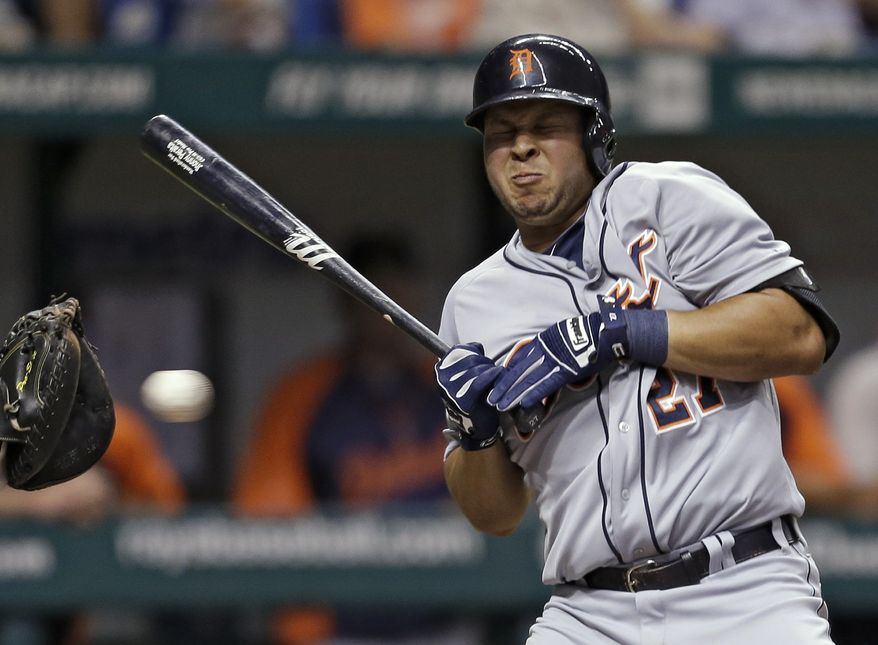FILE - In this June 29, 2013 file photo, Detroit Tigers' Jhonny Peralta reacts as he ducks away from an inside pitch from Tampa Bay Rays starting pitcher Chris Archer during the third inning of a baseball game in St. Petersburg, Fla.  (AP Photo/Chris O'Meara, File)