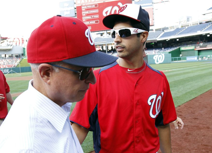 Washington Nationals principal owner Mark Lerner, left, departs after talking with starting pitcher Gio Gonzalez (47) before a baseball against the Atlanta Braves at Nationals Park, Monday, Aug. 5, 2013, in Washington. (AP Photo/Alex Brandon)