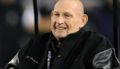 ** FILE ** This Dec. 28, 2008, file photo shows Hall of Fame member and former Baltimore Colts player Art Donovan smiling during a half-time ceremony to commemorate the 50th anniversary of the Colts and New York Giants World Championship Game. Donovan, the Hall of Fame defensive lineman who spent much of his 12-year career with the Baltimore Colts, has died. He was 89. (AP Photo/Gail Burton, File)