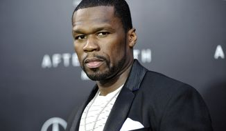 """** FILE ** This May 29, 2013, file photo, shows rapper Curtis """"50 Cent"""" Jackson at the Ziegfeld Theatre in New York. Rapper and actor 50-Cent is scheduled to face arraignment Monday, Aug. 5, 2013, on charges that he attacked his ex-girlfriend and trashed her condo. (Photo by Evan Agostini/Invision/AP, File)"""