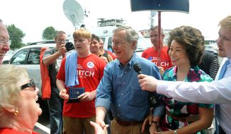 U.S. Sen. Mitch McConnell, Kentucky Republican, greets supporters during the 133rd Annual Fancy Farm Picnic in Fancy Farm, Ky., Saturday, Aug. 3, 2013. (AP Photo/Stephen Lance Dennee)