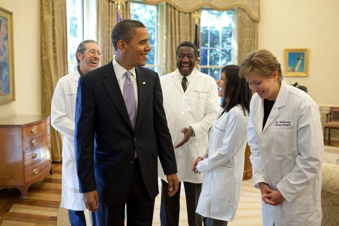 President Barack Obama shares a humorous moment with a group of doctors from around the country in the Oval Office, Oct. 5, 2009, prior to a health insurance reform event at the White House.  (Official White House Photo by Pete Souza)
