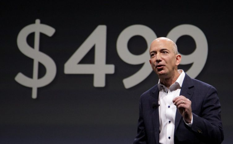 """Washington Post buyer Jeff Bezos was described by Slate magazine as an """"inscrutable libertarian Democrat."""" The Amazon CEO has thrust himself into politics in recent years, with views supporting both Democrats and Republicans. (Associated Press)"""