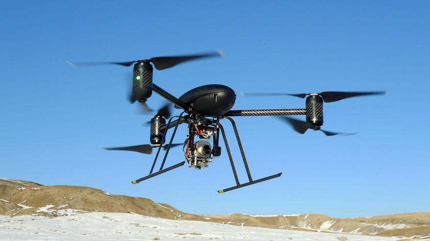 ** FILE ** A small Draganflyer X6 drone is photographed during a test flight in Mesa County, Colo., on Jan. 8, 2009. (Associated Press/Mesa County Sheriff's Department)