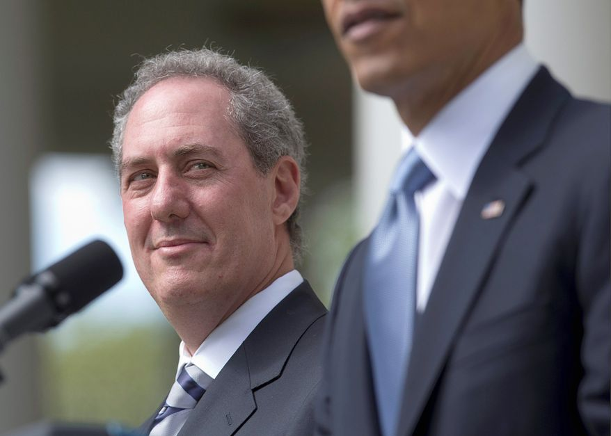 **FILE** Michael Froman, President Obama's choice to become U.S. Trade Representative, listens as the president speaks in the Rose Garden of the White House in Washington on May 2, 2013. (Associated Press)