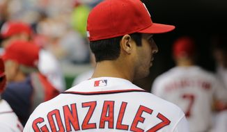 Washington Nationals starting pitcher Gio Gonzalez (47) walks in the dugout before a baseball game against the Atlanta Braves at Nationals Park Monday, Aug. 5, 2013, in Washington. (AP Photo/Alex Brandon)
