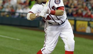 Washington Nationals' Bryce Harper is hit by a pitch from Atlanta Braves starting pitcher Julio Teheran during the fifth inning of a baseball game at Nationals Park Tuesday, Aug. 6, 2013, in Washington. (AP Photo/Alex Brandon)