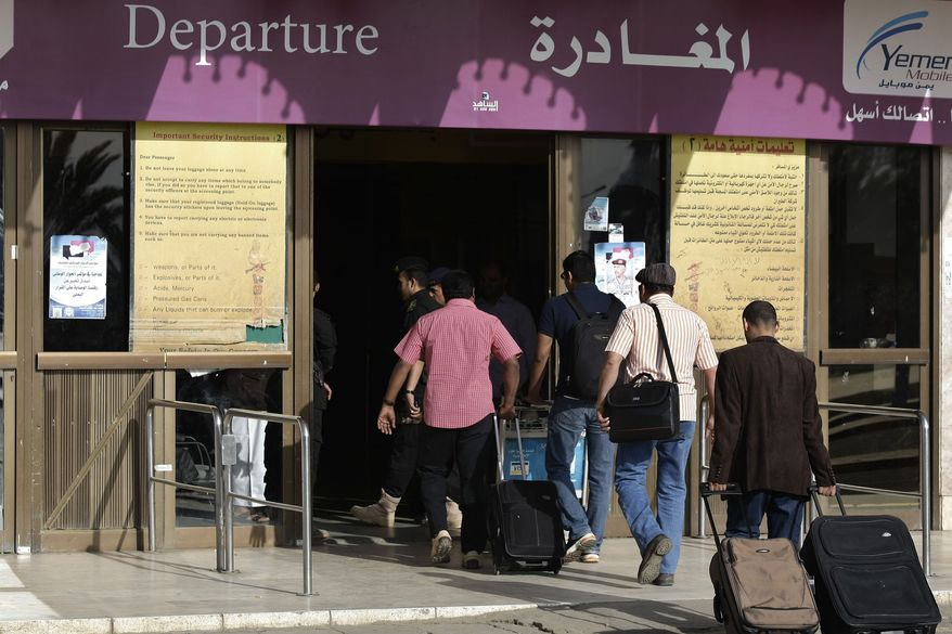Travelers make their way to the departure lounge at Sanaa International Airport, in Yemen, Wednesday, Aug. 7, 2013. The State Department on Tuesday ordered non-essential personnel at the U.S. Embassy in Yemen to leave the country. (AP Photo/Hani Mohammed)