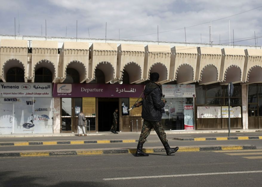A policeman walks as he secures the Sanaa International Airport, in Yemen, Wednesday, Aug. 7, 2013. The State Department on Tuesday ordered non-essential personnel at the U.S. Embassy in Yemen to leave the country. (AP Photo/Hani Mohammed)