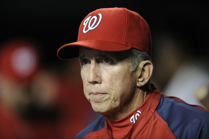 Washington Nationals manager Davey Johnson looks on from the dugout during the sixth inning of a baseball game against the Atlanta Braves, Wednesday, Aug. 7, 2013, in Washington. (AP Photo/Nick Wass)