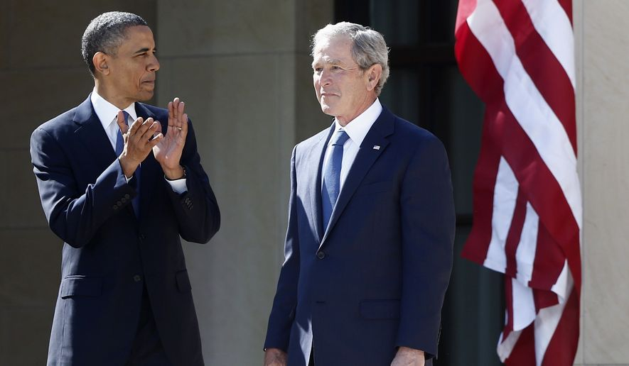 President Obama stands with former President George W. Bush at the dedication of the George W. Bush presidential library on the campus of Southern Methodist University in Dallas on April 25, 2013. (Associated Press) **FILE**