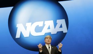 FILE - In this Jan. 17, 2013 file photo, NCAA President Mark Emmert speaks at the organization's annual convention in Grapevine, Texas. (AP Photo/LM Otero, File)