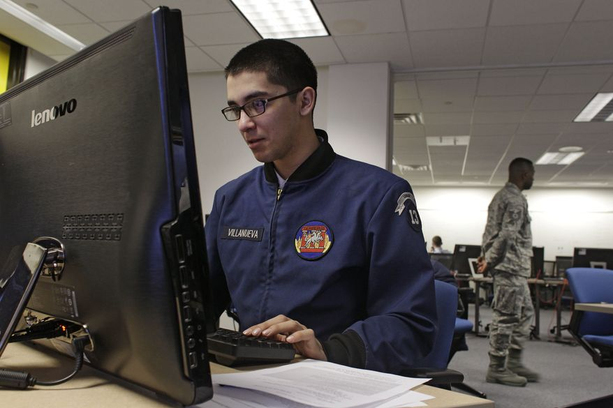 ** FILE ** An Air Force cadet works on Wednesday, Feb. 20, 2013, at a large computer display inside a classroom at the U.S. Air Force Academy's Center for Cyberspace Research in Colorado Springs, Colo., where cyberwarfare is taught. (Associated Press)