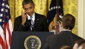 President Obama rubs his eye as he listens to a question from a reporter during a news conference in the East Room of the White House in Washington on Aug. 9, 2013. The president said the U.S. will pause and reassess relations with Russia because of Putin's 'backward' thinking. (Associated Press)