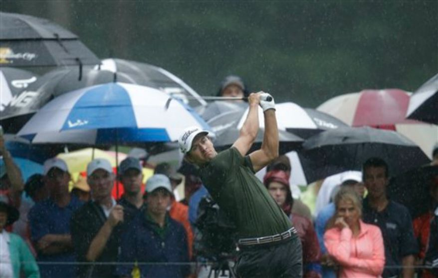 Adam Scott, of Australia, watches his tee shot on the 11th hole during the second round of the PGA Championship golf tournament at Oak Hill Country Club, Friday, Aug. 9, 2013, in Pittsford, N.Y. (AP Photo/Charlie Neibergall)