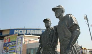 ** FILE **  New York City police are investigating swastikas and hate speech scrawled on a statue of Pee Wee Reese and Jackie Robinson outside Brooklyn's minor league baseball stadium. A manager at MCU Park noticed the defacement Wednesday morning, Aug. 7, 2013. (AP Photo/Brooklyn Cyclones)
