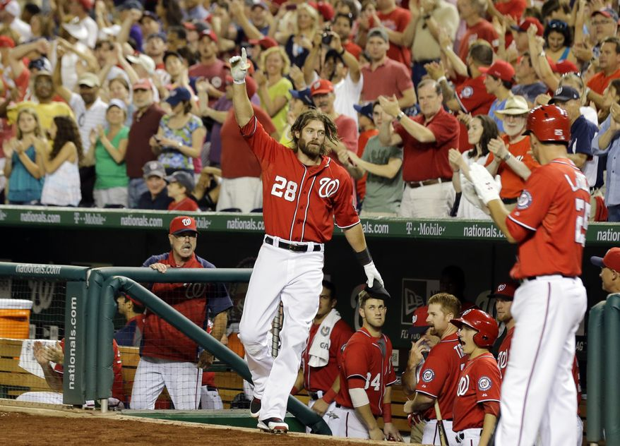 Washington Nationals outfielder Jayson Werth takes a curtain call after crushing a two-run homer to left field to give the Nationals a 6-4 lead over the Phillies and notch his 1,000th career hit. (Associated Press photo)