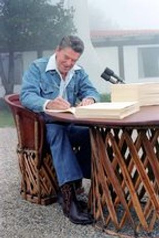 ** FILE ** President Reagan signs the Economic Tax Recovery Act on Aug. 13, 1981. (Ronald Reagan Library)