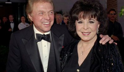 """** FILE ** In this May 30, 1998, file photo, Steve Lawrence and Eydie Gorme arrive at the black-tie gala called """"Thanks Frank"""" honoring Frank Sinatra in Las Vegas. Gorme, a popular nightclub and television singer as a solo act and as a team with husband Steve Lawrence, has died. She was 84. (AP Photo/Lennox McLendon, File)"""