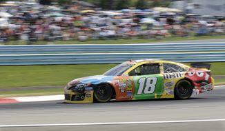 Kyle Busch (18) drives during a NASCAR Sprint Cup Series auto race at The Glen, Sunday, Aug. 11, 2013, in Watkins Glen, N.Y. (AP Photo/Mel Evans)