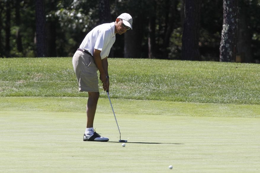 President Barack Obama putts while golfing on the first hole at Farm Neck Golf Club in Oak Bluffs, Mass., on the island of Martha's Vineyard on Sunday, Aug. 11, 2013. (AP Photo/Jacquelyn Martin)