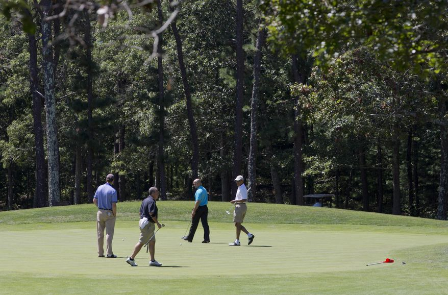 President Barack Obama, right, plays golf on the first hole at Farm Neck Golf Club in Oak Bluffs, Mass., on the island of Martha's Vineyard with, from left, aide Marvin Nicholson, Robert Wolf, a Wall Street consultant, and White House chef Sam Kass, on Sunday, Aug. 11, 2013. (AP Photo/Jacquelyn Martin)