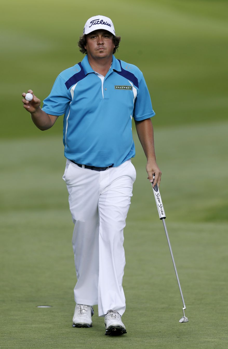 Jason Dufner waves after a par on the 13th hole during the final round of the PGA Championship golf tournament at Oak Hill Country Club, Sunday, Aug. 11, 2013, in Pittsford, N.Y. (AP Photo/Patrick Semansky)