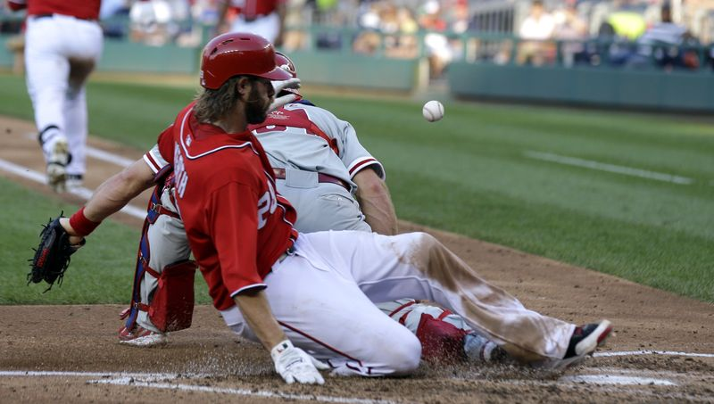 Jayson Werth slides safely into home plate in the fifth inning on Sunday in the Washington Nationals' 6-0 win over the Philadelphia Phillies. (Associated Press photo)