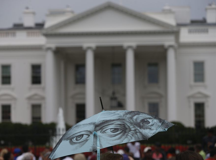A tourist's umbrella is seen in front of the White House on Pennsylvania Avenue in Washington, Saturday, Aug. 10, 2013, after President Barack Obama and his family left for their vacation in Martha's Vineyard. (AP Photo/Charles Dharapak)