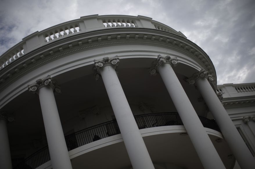 The South Portico of the White House is seen before President Barack Obama and first lady Michelle Obama walk on the South Lawn at the White House in Washington, Saturday, Aug. 10, 2013, as they travel to Orlando, Fla. before heading to their vacation in Martha's Vineyard. (AP Photo/Charles Dharapak)
