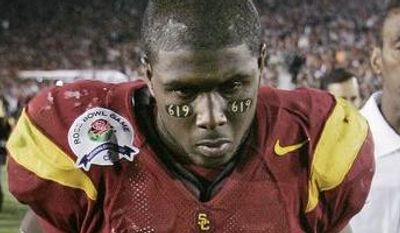 **FILE** Southern California running back Reggie Bush leaves the field after USC lost to Texas 41-38 in the Rose Bowl, the national championship college football game in Pasadena, Calif., Wednesday, Jan. 4, 2006. (AP Photo/Chris Carlson)