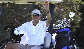 President Obama waves to a group of on-lookers while golfing at Farm Neck Golf Club in Oak Bluffs, Mass., on the island of Martha's Vineyard on Aug. 11, 2013. (Associated Press)