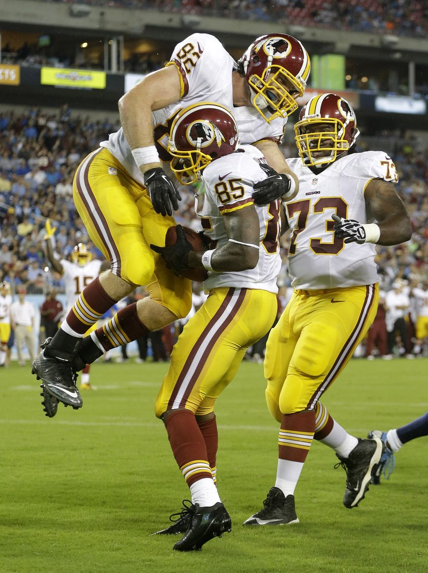 Washington Redskins wide receiver Leonard Hankerson (85) celebrates with tight end Logan Paulsen (82) and guard Adam Gettis (73) after scoring a touchdown on an 8-yard pass play against the Tennessee Titans in the second quarter of a preseason NFL football game on Thursday, Aug. 8, 2013, in Nashville, Tenn. (AP Photo/Wade Payne)