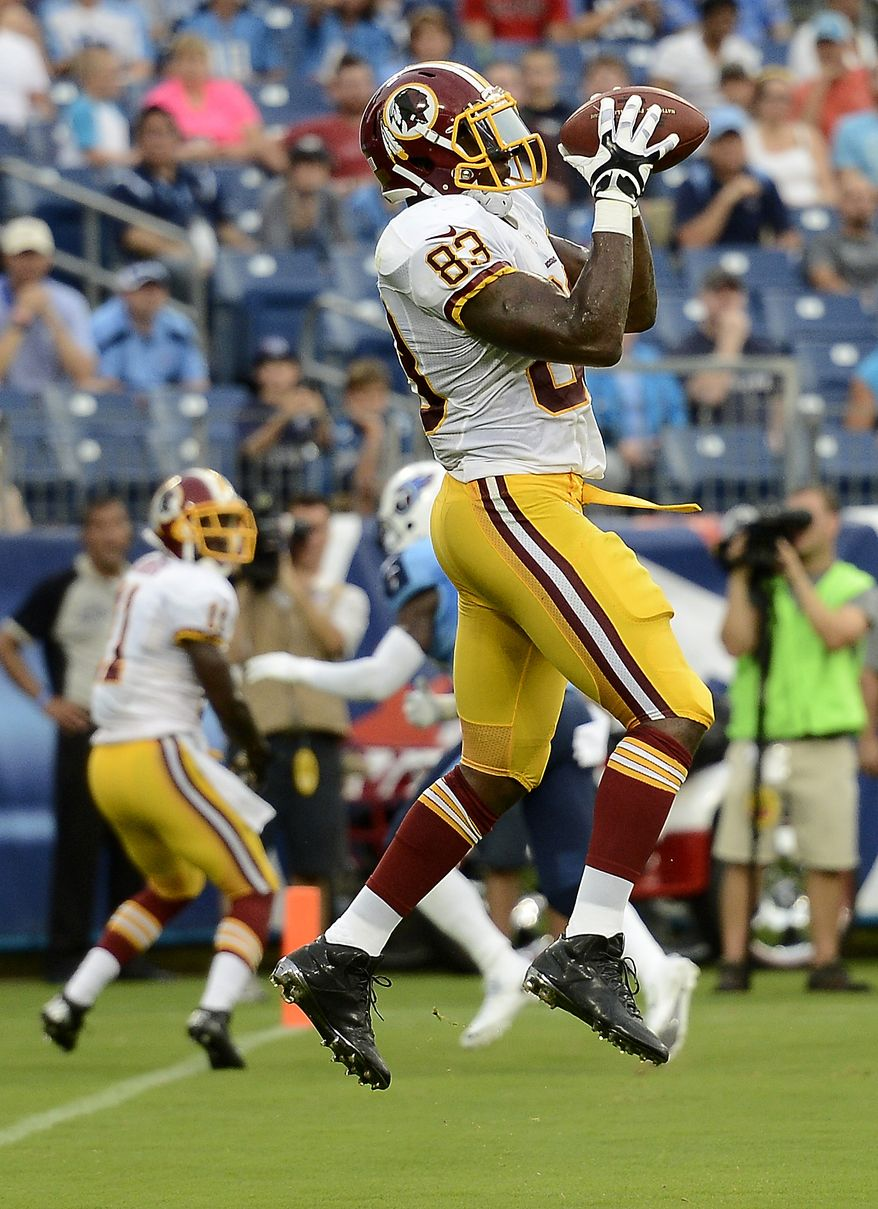 Washington Redskins tight end Fred Davis catches a 3-yard touchdown pass against the Tennessee Titans in the first quarter of a preseason NFL football game on Thursday, Aug. 8, 2013, in Nashville, Tenn. (AP Photo/Mark Zaleski)