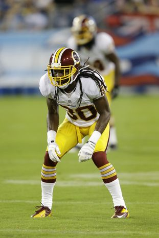 Washington Redskins cornerback E.J. Biggers get set against the Tennessee Titans in the second quarter of a preseason NFL football game on Thursday, Aug. 8, 2013, in Nashville, Tenn. (AP Photo/Wade Payne)