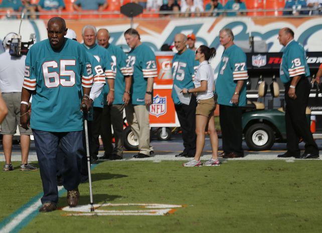 Former Miami Dolphins player Maulty Moore is introduced during a halftime ceremony of the Dolphins' game against the Jacksonville Jaguars in Miami on Dec. 16, 2012. All the members of the Dolphins' 1972 undefeated championship team were honored during the ceremony. (Associated Press)