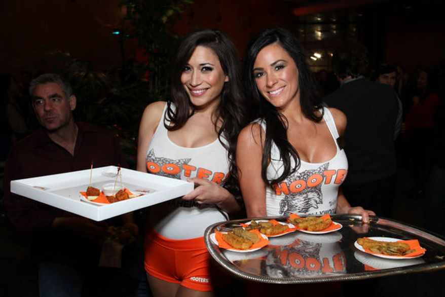 ** FILE ** Hooters girls (Associated Press)