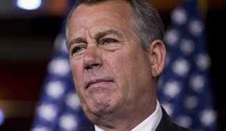 **FILE** House Speaker John Boehner, Ohio Republican, takes questions from reporters at a Capitol Hill news conference on Aug. 1, 2013, as Congress prepares to leave Washington for a five-week recess. (Associated Press)
