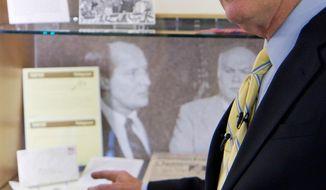 ** FILE ** In this Sept. 16, 2011, file photo, U.S. Sen. Lamar Alexander, R-Tenn., discusses papers and memorabilia on display in an exhibit about his political career at Vanderbilt University in Nashville, Tenn. (AP Photo/Erik Schelzig, file)