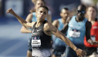 **FILE** Matthew Centrowitz reacts as he wins the senior men's 1500-meter run at the U.S. Championships athletics meet, Saturday, June 22, 2013, in Des Moines, Iowa. (AP Photo/Charlie Neibergall)