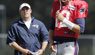 New England Patriots quarterback Tom Brady (12) talks with offensive coordinator Josh McDaniels during a joint workout with the Tampa Bay Buccaneers at NFL football training camp, in Foxborough, Mass., Wednesday, Aug. 14, 2013. (AP Photo/Charles Krupa)