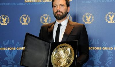 """** FILE ** Ben Affleck poses backstage with his award for outstanding directorial achievement in feature film for """"Argo"""" at the 65th annual Directors Guild of America Awards at the Ray Dolby Ballroom on Saturday, Feb. 2, 2013, in Los Angeles. (Chris Pizzello/Invision/AP)"""