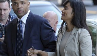 ** FILE ** Former Rep. Jesse L. Jackson Jr., Illinois Democrat, and his wife, Sandra, arrive at federal court in Washington on Wednesday, Aug. 14, 2013, to learn their fates when a federal judge sentences the one-time power couple for misusing $750,000 in campaign money on everything from a gold-plated Rolex watch and mink capes to vacations and mounted elk heads. (AP Photo/Susan Walsh)
